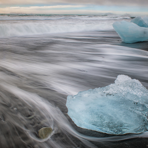 Jokulsarlon (Iceland) black sand beach with ice crystal - Iceberg on beach